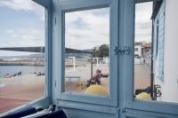 Pedocin. A view of the men side through a window.