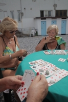 Sandra. I come here to play cards with my friends diva, Anna and Rosanna. We play Burraco. It
